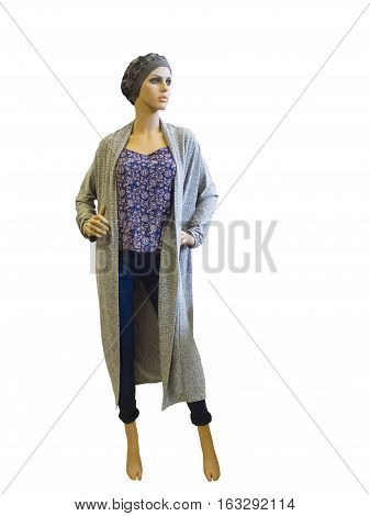Full-length female mannequin wearing long cardigan top and blue jeans. Isolated on white background. No brand names or copyright objects.
