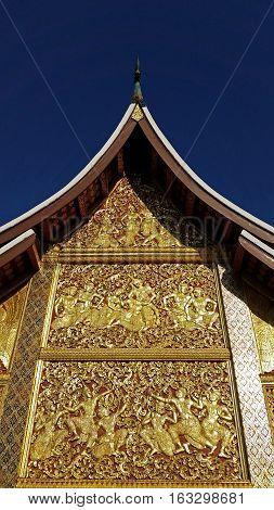 Asian wooden art at Wat Xieng Thong Buddhist temple in Luang Prabang World Heritage Laos