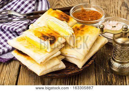 Fried pita bread with cheese. Studio Photo