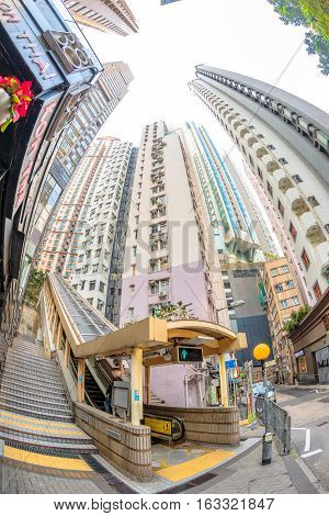Hong Kong, China - December 4, 2016: The final section of Central-Mid-levels escalator, the world's longest escalator system, from Mosque Street to Conduit Road. Fish eye lens view.
