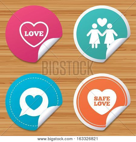 Round stickers or website banners. Lesbians couple sign. Speech bubble with heart icon. Female love female. Heart symbol. Circle badges with bended corner. Vector