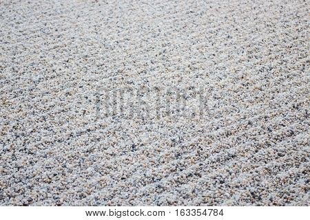Zen gardens typically contain gravel pattern stock photo
