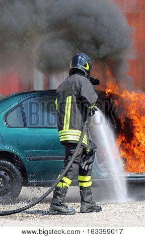 Fireman Extinguishes The Fire Of A Car With Foam