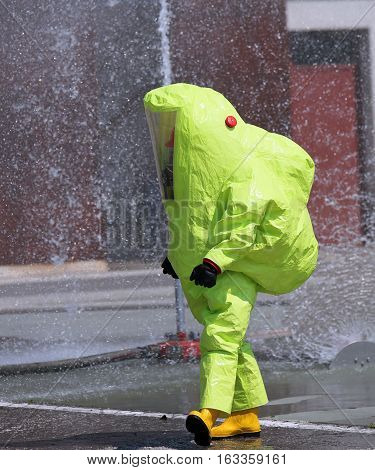 Firefighter With Big Yellow Suit Against Biological Risk