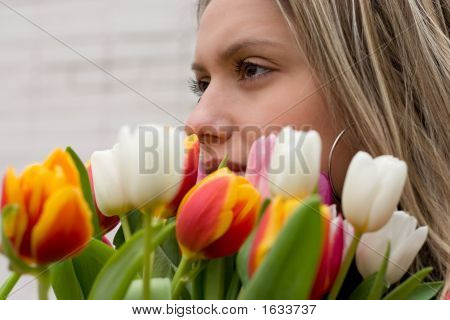 Girl With Bouquet Of Tulips