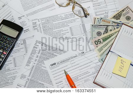 taxation concept: form with calculator money pen