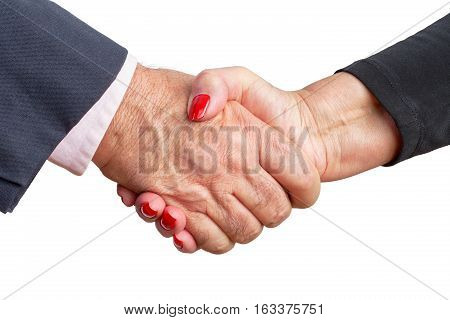 Close up view of a stylish elderly couple shaking hands to affirm their love and commitment to one another for Valentines Day