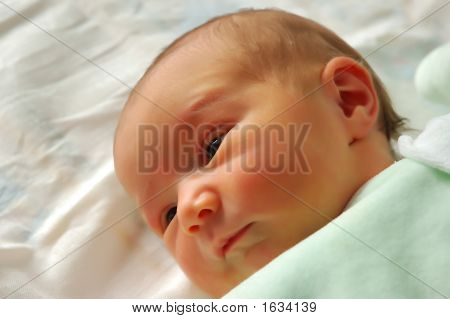 A Small Beautiful Smiling Baby After Sleeping