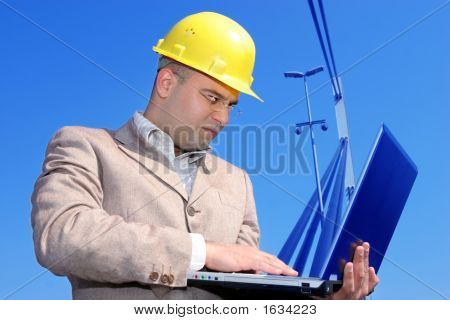 Architect With Laptop At A Bridge