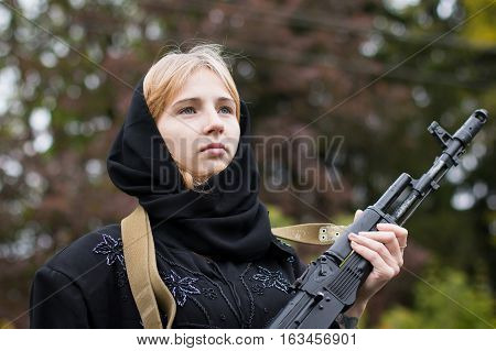 Woman In Muslim Dress With Arms