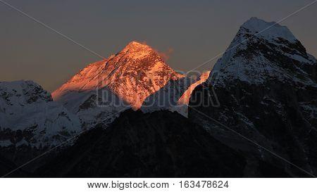 Highest mountain of the world at sunset. Illuminated peak of Mt Everest.