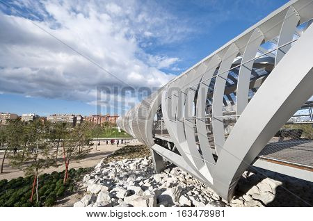 Arganzuela Bridge on 15 April 2013, in Madrid Rio Park, Madrid, Spain. Designed by Dominique Perrault it is 274 metres in lenght and formed by two spiral-shaped walkways connected by a hill giving access to Arganzuela Park.