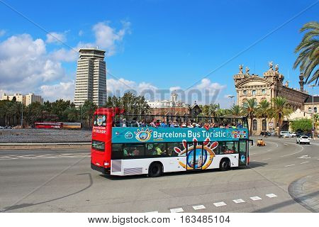 BARCELONA, SPAIN - OCTOBER 8, 2013: Barcelona Bus Touristic. 3 routes with 1 ticket. Open-top double decker bus. Audioguide in 10 languages