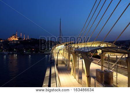 Halic Metro Bridge and Suleymaniye mosque in Istanbul, Turkey.