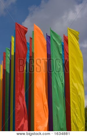 Several Colorful Festival Flags Fluttering In The Sky