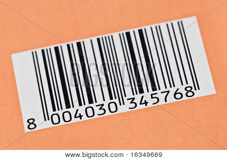 barcode on orange background closeup
