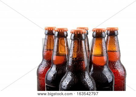 Chilled beer bottles with water droplets on