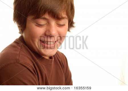 cute young teen boy with a bashful grin