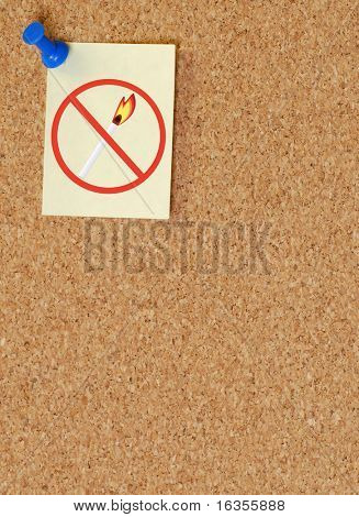 no open flames sign on tacked to note on corkboard