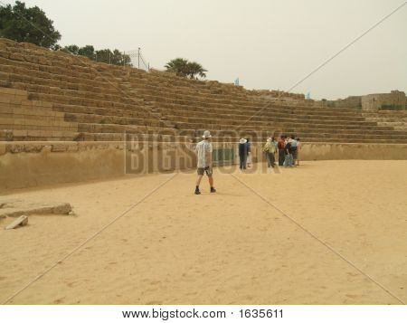 Tourists In The Old Roman Theatre In Caesarea