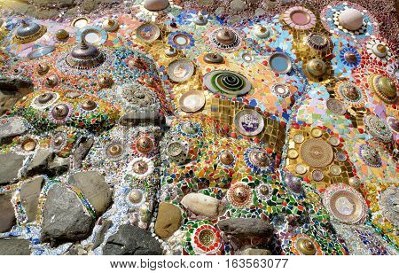 wall decorated with colorful ceramic glass Unseen in Wat Phra That Pha Sorn Kaew Phetchabun Thailand.