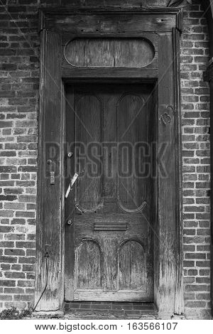 An old weathered wooden door from the French Quarter of New Orleans in Louisiana.