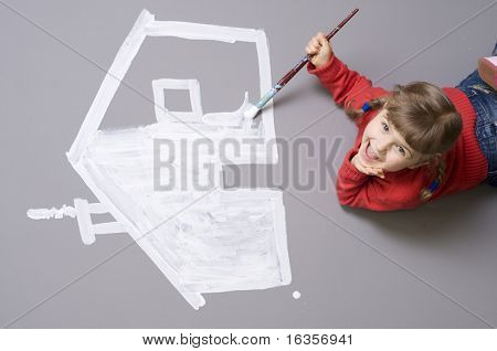 Little girl painting house symbol