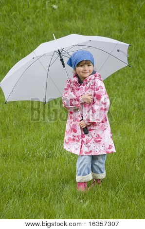Little girl in the rain