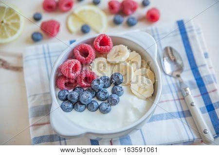 Healthy Yogurt with fresh fruit on a table