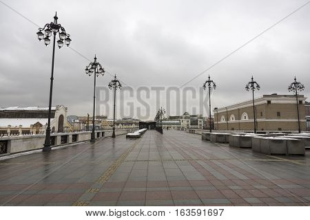MOSCOW RUSSIA - DECEMBER 25 2016: Pedestrian Patriarchal bridge in cloudy weather