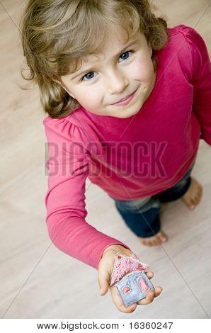 Little house on cute girl hand