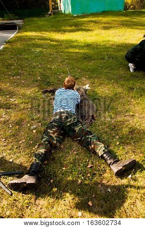 Tyumen, Russia - September 22, 2012: Miles of Fire festival of live history on basis of Avanpost center. Young man took aim with air gun
