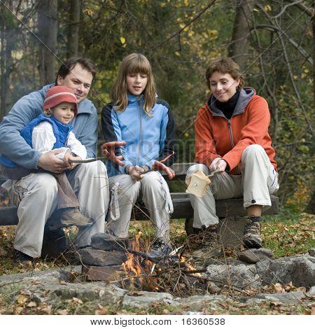 Happy family near campfire