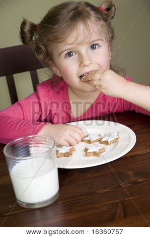 Little girl eating cookies