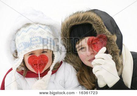 Cute girls licking a lollipop