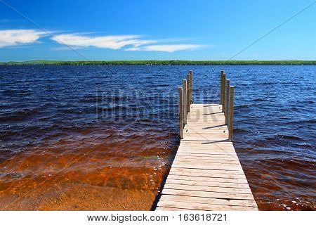 Wooden pier and choppy waters of Lake Gogebic at Ontonagon County Park Michigan.