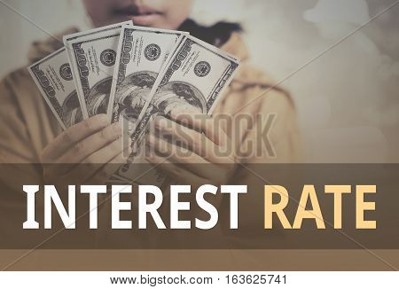 Interest Rate Word Over Young Girl Holding Dollar Bills.