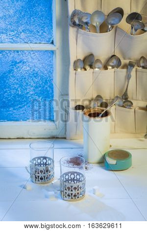 Hot Cup And Coffee Pot With Spoons In Winter