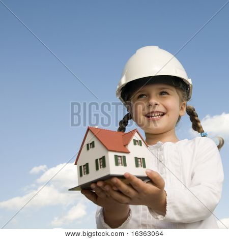 New house model on girl hands