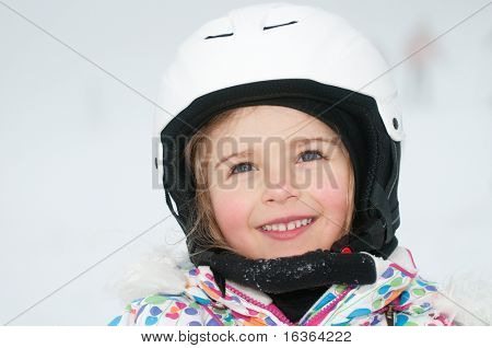 Cute little skier winter portrait