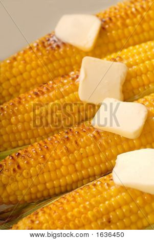Four Ears Of Roasted Corn With Butter