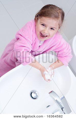 Cute girl washing hands