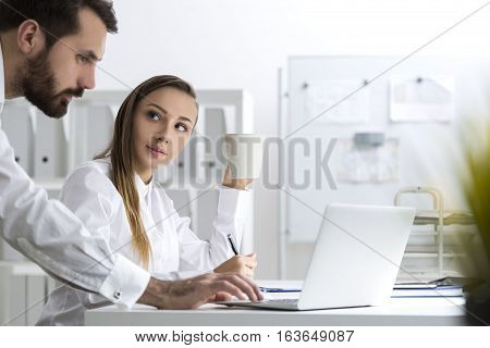 Bearded Man And A Woman In An Office