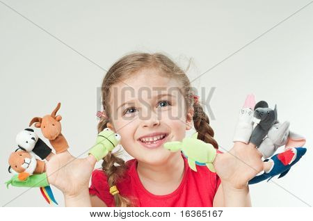 Little girl hands wearing 10 finger puppets (no-name toy)
