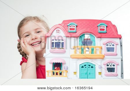 Playing with doll's house  (no-name toy)
