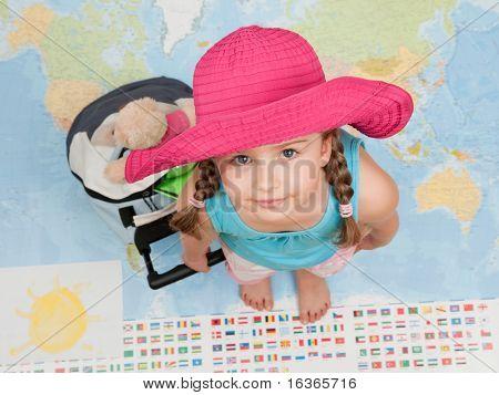 Bereit für die Reise auf der ganzen Welt (Karte im Hintergrund unscharf)
