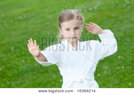 Little girl exercising tai chi