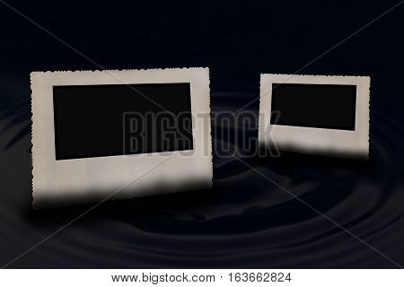 Two bevelled old vintage photo frames with jagged edges horizontally partially submerged in the water circle wave. One photo is in the foreground and a second smaller in the background.
