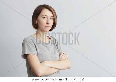 Offended and dissatisfied girl crossed her arms at chest