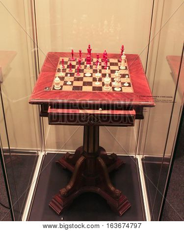 Gatchina, Russia - 3 December, The exposition of vintage chess with a table, 3 December, 2016. Visit the Museum Reserve Gatchina Palace.
